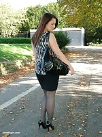 Hot brunette Sara is posing outdoors in her silky black nylons and tall shiny heels