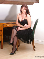Jackie in little black dress and black stockings