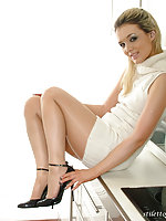 This slender blonde looks amazing in a white dress and black high heels