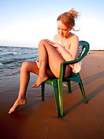 Raunchy chick showing her tempting feet in wet pantyhose at the seaside