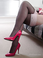 Sex-mad Milf Jenny is hold in abeyance at hand seduce you on the bed in her sexy lingerie, stockings and high heels