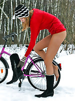 Frisky chick going on a cycle ride right in her silky pantyhose in winter