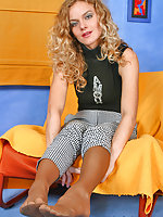 Blonde chick in tan pantyhose going all the way to touch her pink tenderly