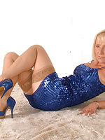 These are some incomparable blue high heel stilettos worn by a horny blonde