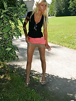Classy blonde wearing shiny hose getting to bold upskirt flashing outdoors