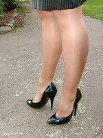 Donna is posing outside in her very horny bumptious heels and short skirt.