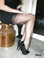 Nylon Jane wearing a sleek black dress and stockings