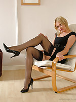 Gorgeous blonde Caroline attaches her suspender belt to her sexy nylons, and then can't thumb one's nose at a tease of her long stockinged legs and high heels